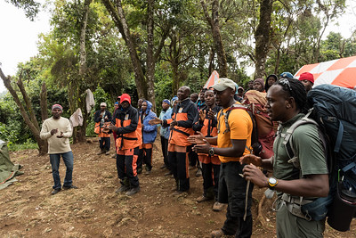 The guides and porters welcome us to the Forest Camp at the end of the first day.