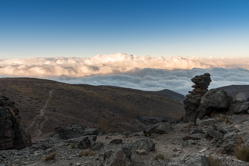 Morning undercast at Lava Tower campsite, with a view of the trail ahead.