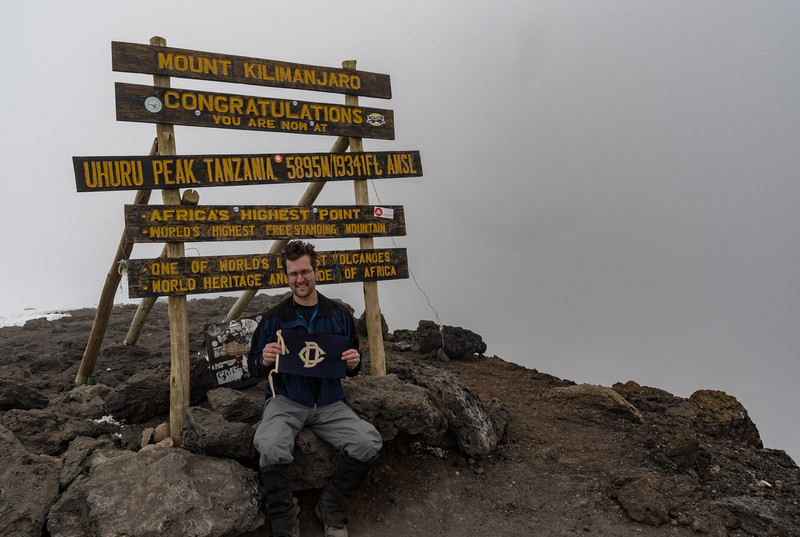 David Kotz #12190 with the Dudley Flag of his grandfather Sydney Cowlin #4430, on the summit of Uhuru Peak, Mount Kilimanjaro, Tanzania.