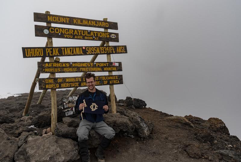 David Kotz #12190 with the Dudley Flag of his grandfather Sydney Cowlin #4430, on the summit of Uhuru Peak, Mount Kilimanjaro, Tanzania.