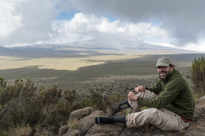 Ken adjusts his boots at an overlook of the Shira Plateau, as we shift from heather zone to moorland.