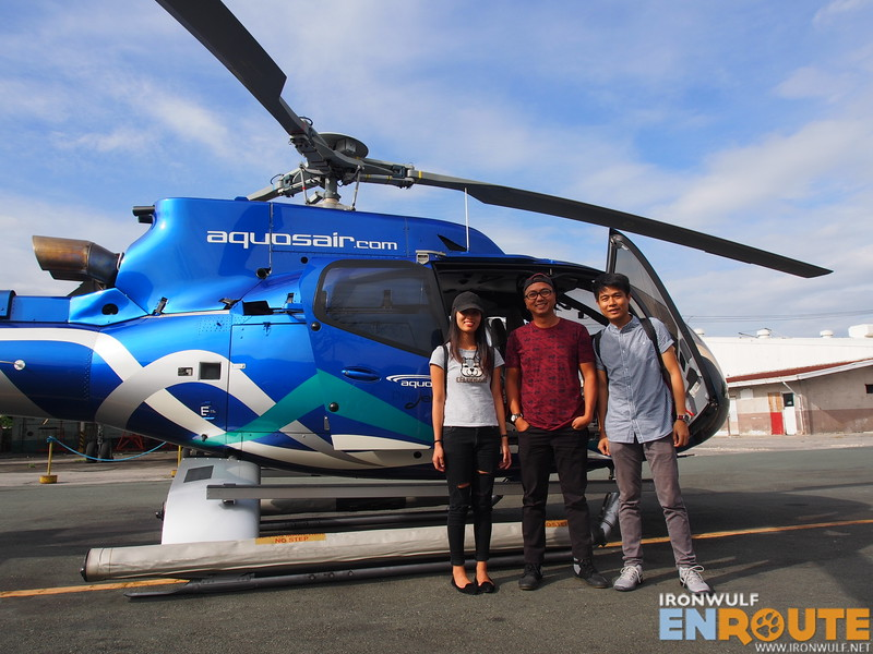 The three ArchipelagoPH photo contest winners Hana, William and Rey with the EC130 T2 Helicopter
