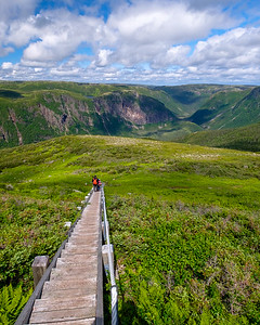 Heading down a long rugged stair case descending the back of Gros Morne Mountain in one of the steepest rockiest parts.