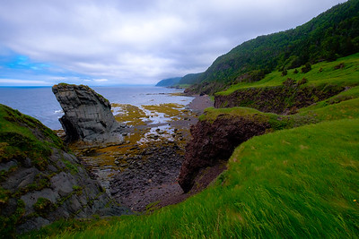 Sea stack and verdent headlands extending along the Green Garden trail into the distance.