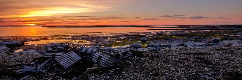 Enjoying the sunset near Flowers Cove, surrounded by discarded and washed up lobser pots.