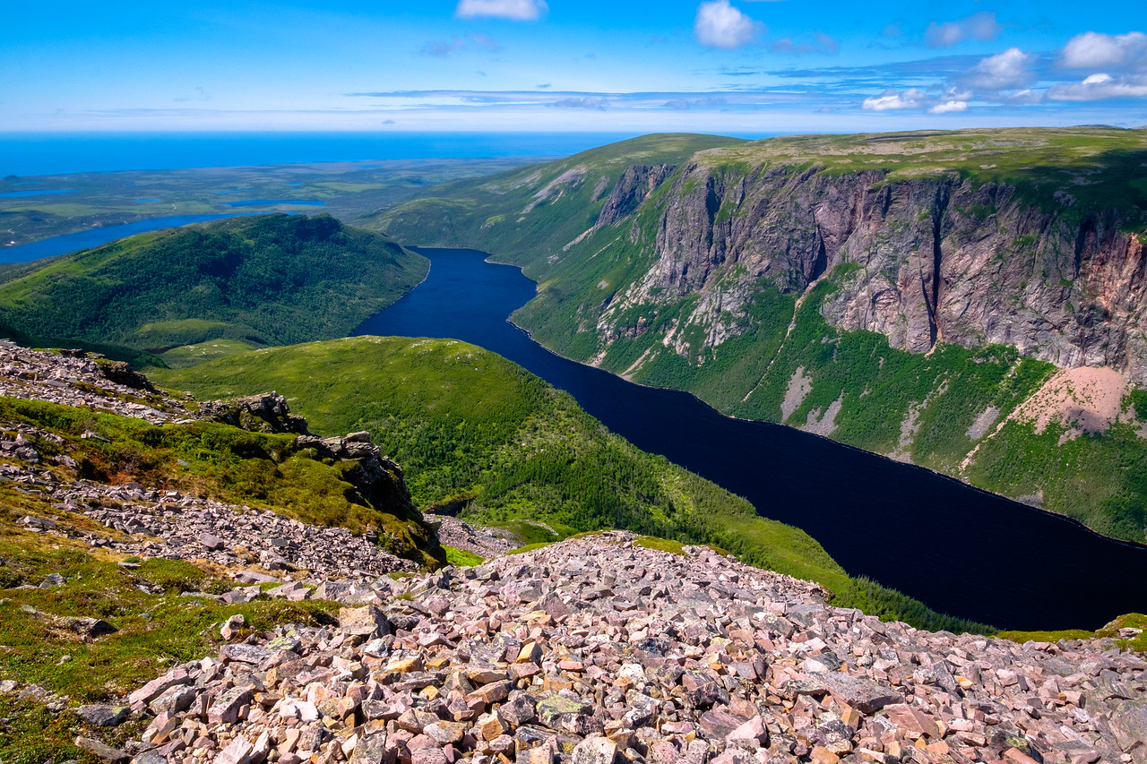 Circling the top of Gros Morne Mountain and looking down into Ten Mile Pond, a water-filled fjord locked from the sea by the glacial morraine fields that extend along the coast.