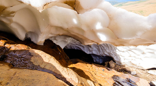 Peering into the bowels of the snow gave from the melting feathered edges of the snow pack area.