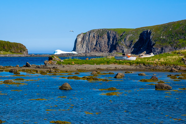 Derelict small fishing boats on an island in Noddy Cove Newfoundland.