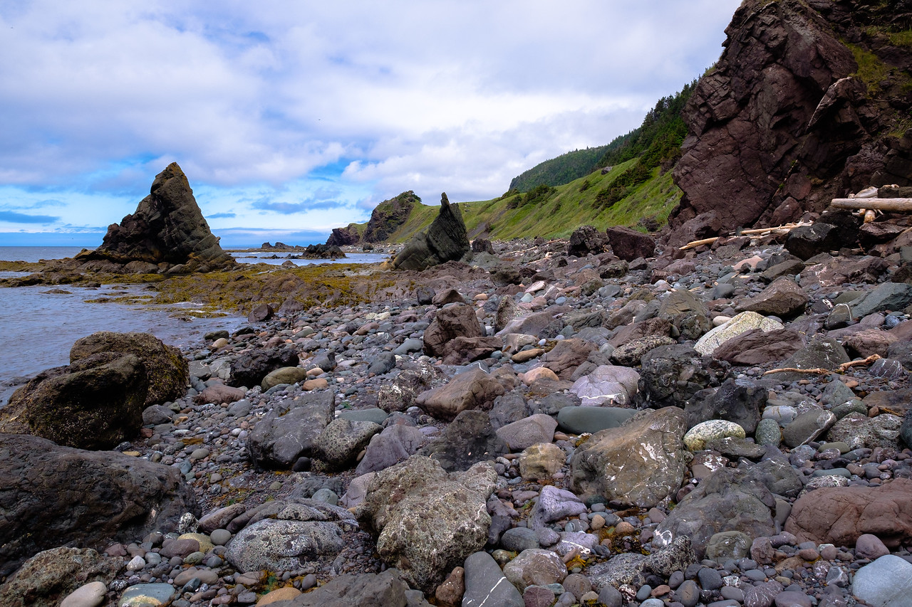 Coastal rubble and basalt volcanic sea stacks along the Green Garden trail.