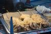 Fried squid on a stick - Ramadan festival, Singapore.