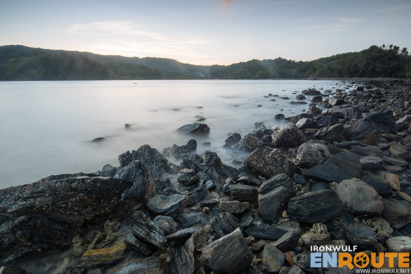 The rocky beach facing the sunset