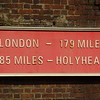 Add them up - 264 miles by train - approx. 5 hours - Changing at one of the three switches.