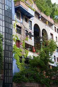 Friedensreich Hundertwasser (1928-2000) Austrian designer, philosopher, environmental activist. He later added Regental and Dunkelbunt to his name. Died on Queen Elisabeth near New Zeeland. A very interesting village, not to miss!