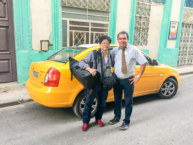 Victor Daniel, pick me up at the airport.  He used to be a government official working for Ministry of Foreign Affairs.  He bought a car, and works as a taxi driver which give me much greater income.