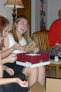 Katie opening up her gifts.
