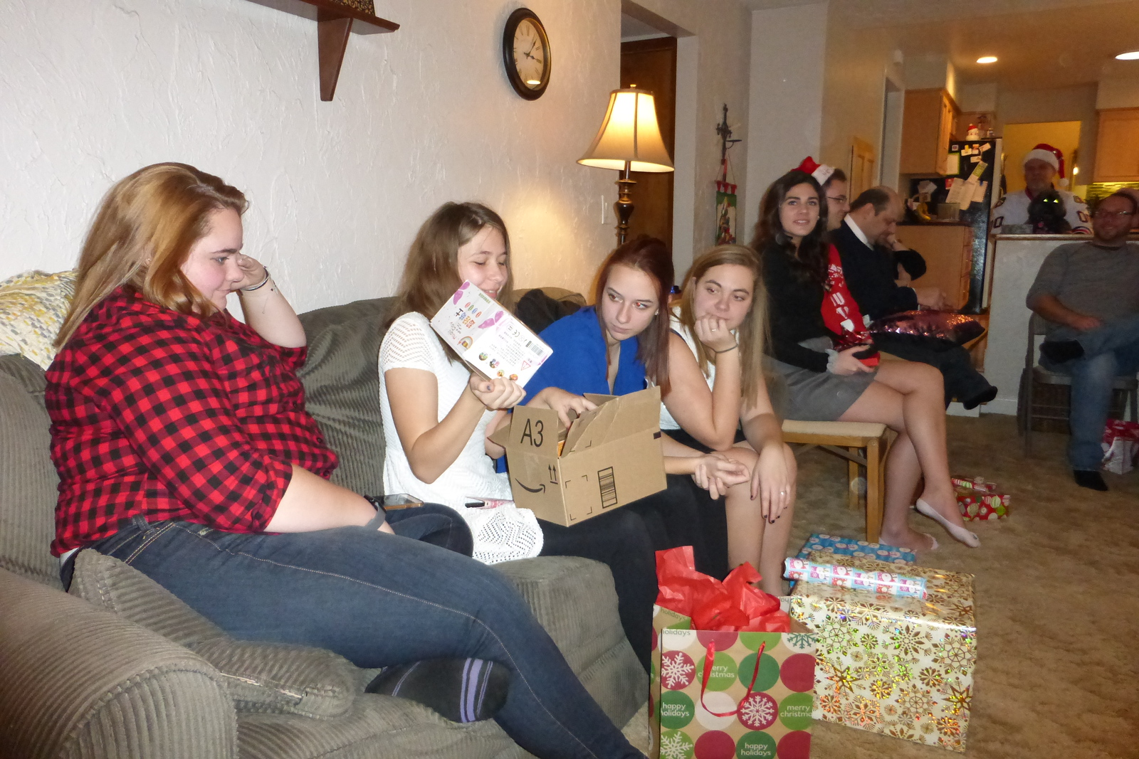 Lauren's turn to open her gifts. (modeling clay)