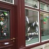 I saw Christmas-themed window origami in at least two houses.