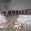 Near the Curia were the remains of a house that had a hypocaust, i.e. under-floor heating.