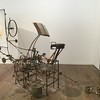 Tinguely made a lot of machines that produced artworks, and the sculptures involved in The Transport included this drawing-machine and also a sculpting-machine - along with a machine for destroying sculptures, which I think alas no longer exists. The book on the stand is a phonebook.