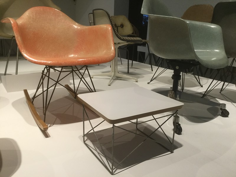 "The Eamses were fascinated by the question of how to produce a high-quality, mass-produced chair with a one-piece seat. They first looked at plywood, but that tended to split in the forming process, and then they tried aluminium, but that was cold and noisy, and then they hired a boatbuilder to make two prototypes in fibreglass - and their problem was solved.  When I stayed in the Ace Hotel in Seattle for the first time in 2010, <a href=""https://kelper.smugmug.com/Travel/2010/Travel-2010-USA/Seattle/SeattleMisc/i-JBMQdWG"">there was a fibreglass rocking-chair in my room</a>, and it proved to be the most comfortable chair I'd ever met. The first few days of my visit were very rainy, but I was very happy sitting by the window with my free hotel coffee and my books, looking out at the rain and doing some gentle rocking.  I learned afterwards that the chair was a reproduction of this Eames RAR design. One can buy such a reproduction fairly cheaply, but unfortunately it just would not go with the style of my flat."