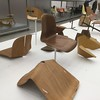 Some of the Eames experiments with seating design. The plywood chairs kept on breaking during the moulding process, especially along the back. They tried to reduce the stresses on the material by making cuts and notches in the places most prone to splitting, but it didn't work and in the end they decided to separate the backrest and the seat.