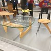 "The glass-topped coffee table is by Noguchi. There is a <a href=""http://fuckyournoguchicoffeetable.tumblr.com/"">now-dormant blog that features the Noguchi coffee table in the name</a> and that pokes fun at affectations in domestic decor."