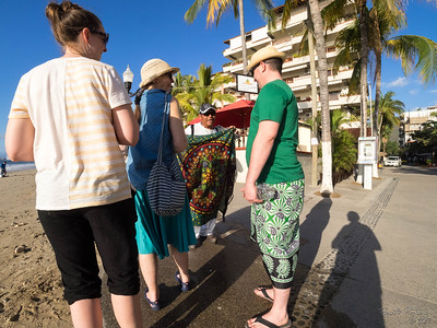 Selling Jesse a sarong on the beach