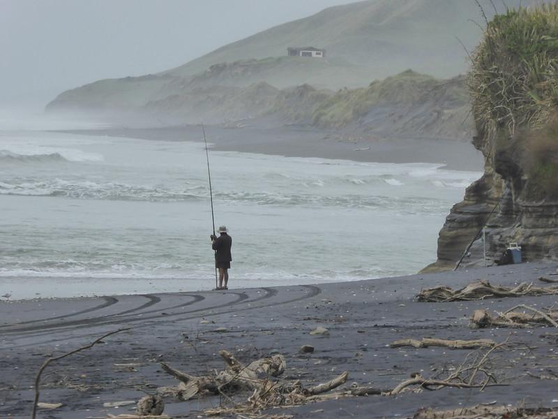 Awakino Heads fisherman