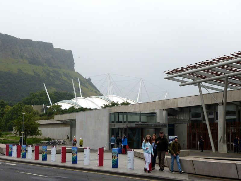 Exterior of the Scottish Parliament Building, Edinburgh, with Arthur's Seat in the background.