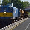 112 + 4 empty ballast wagons pass through Lisburn , 0945 Belfast Central Parcel Siding / Poyntzpass.<br /> <br /> The transfer had been operating around 25 minutes behind it's booked path due to operational problems at Belfast Central. Fri 04.08.17