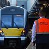 The Dispatcher of Platform 3 + 4 watches the train depart Belfast Central. Fri 04.08.17