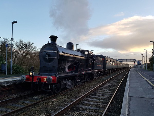 """""""Q"""" class 4-4-0 No.131 arrives at Whitehead with the 1500 Belfast Central / Whitehead RPSI Sdg test run. The locomotive operated two return trials with the Mk2 carriages to Belfast and one in the morning by itself to Carrickfergus. Sun 05.11.17 (With thanks to Michael McCabe)<br /> <br /> A little history on the life of 131 is shown below - <br /> <br /> <br /> BuilderNeilson Reid, Glasgow, February 1901, works number 5727<br /> WithdrawnCIÉ, 1963<br /> CompaniesGNR(I), GNRB, CIÉ, RPS<br /> Preservation CareerIn store, 1963-2014. Restored 2015<br /> TendersVarious, new body being constructed<br /> Current LocationWhitehead Railway Museum<br /> Current StatusUndergoing overhaul at Whitehead, part of a GROW funded project<br />  <br /> <br /> The Railway Preservation Society of Ireland took delivery of a new resident to its Whitehead engineering base on the 31st May 2003. The resident in question was """"Q"""" class 4-4-0 No.131.<br /> <br /> No.131 was built in February 1901 as part of a class of 13 4-4-0 express passenger locomotives for the Great Northern Railway (Ireland). They supplanted the various P and PP classes and were only displaced by the S class. The 4-4-0 tender locomotive was built by Neilson Reid in Glasgow. No.131 was designed under the auspices of Charles Clifford and although initially named, the name was removed in 1914. She was rebuilt with a superheated boiler, under George T. Glover (then Chief Locomotive Designer of the GNR(I)) in Dundalk works in 1920.<br /> <br /> She was used mainly on the routes from Belfast to Clones and Belfast to Londonderry and throughout her GNR(I) life was rarely seen south of Dundalk. She was overhauled again in 1958 at Dundalk and in October 1958 when the Great Northern Railway board split between the Ulster Transport Authority and Córas Iompair Éireann, the locomotive passed into the hands of CIÉ for operation until withdrawal in October 1963. Between 1963 and 1965 she lay unused along with (now, also preserved at the R"""