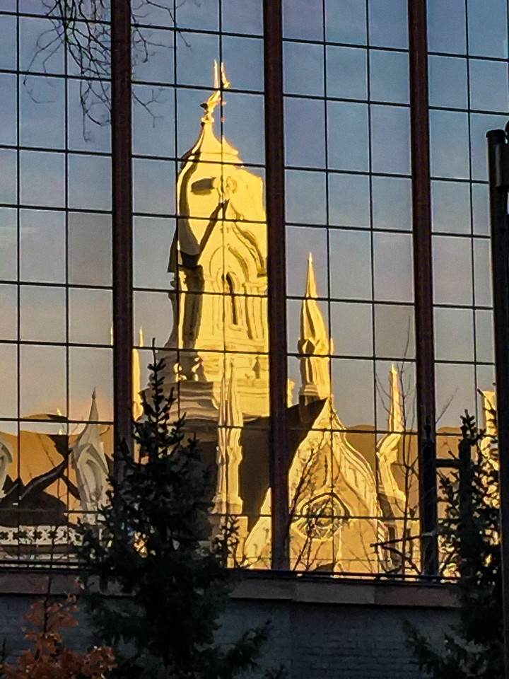 The Meeting House reflected in a nearby building