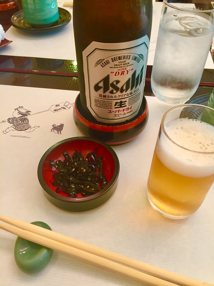 Beer comes with seaweed at this restaurant outside of Ueno Park.