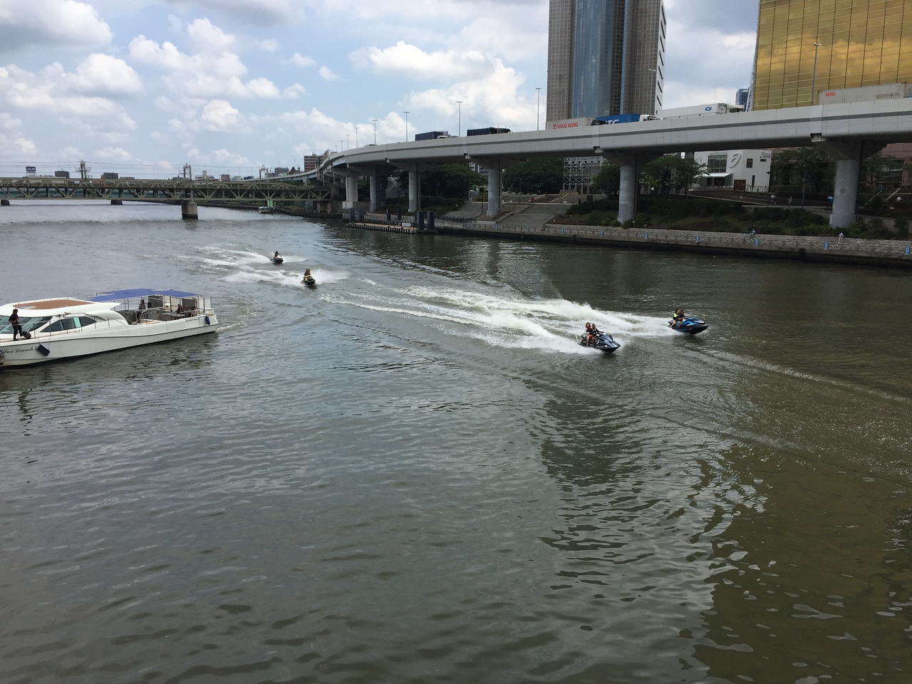 Jet skiers on the Sumida River
