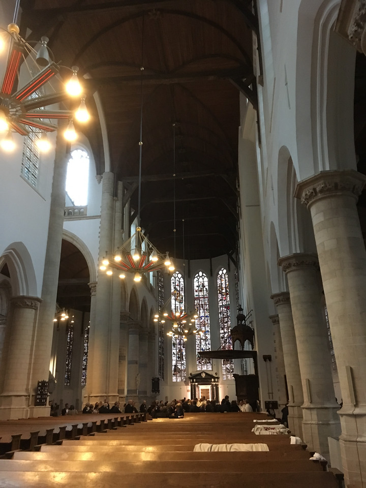 Old Church in Delft, with a formal reception underway.