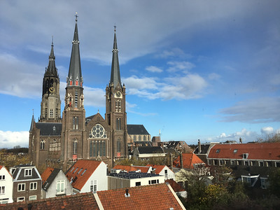 The spire of Nieuwe Kerk, behind another church, as viewed from my hotel room in Delft.