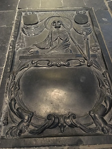 A curious gravestone on the floor of the Old Church in Delft.