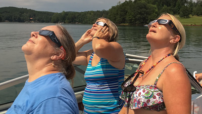 Pam, Karen, and Amy view the sun as they anticipate the total eclipse.