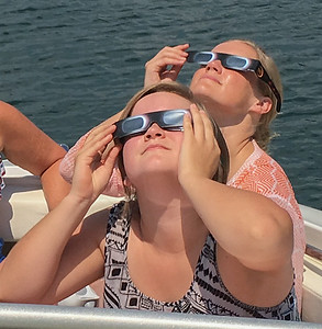 Mara and Ashely view the sun as it heads toward total eclipse.