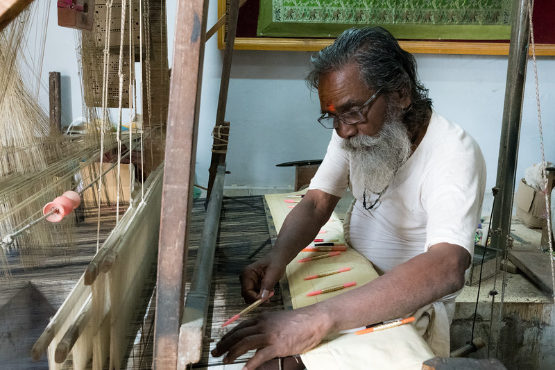 Silk weavers demonstrate their craft in Varanasi.