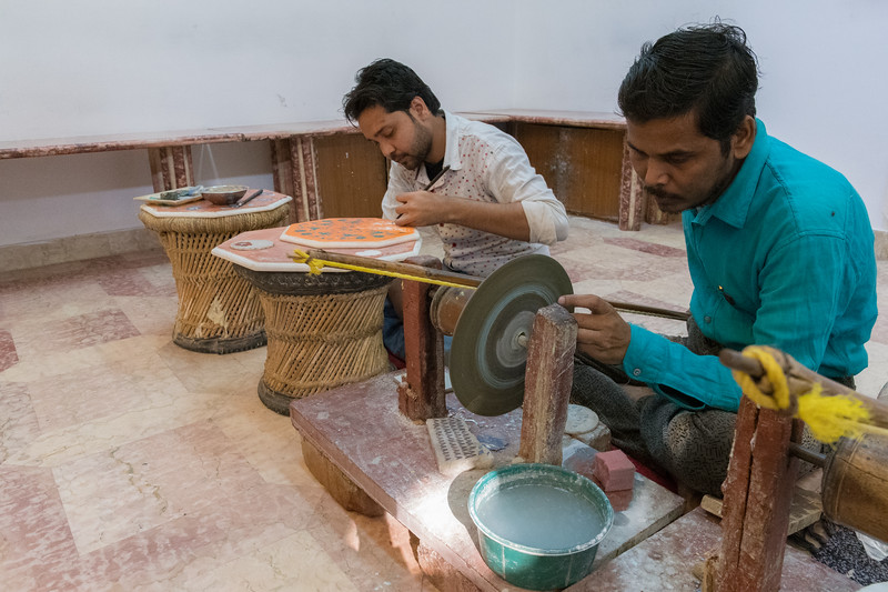 Marble inlay workers demonstrating their craft at a shop in Agra.