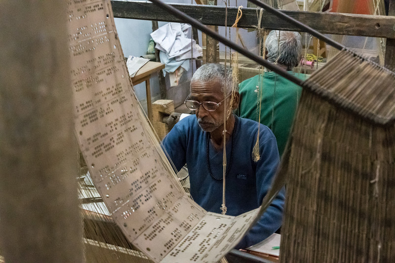 Silk weavers demonstrate their craft in Varanasi; notice the Jaquard-style cards.
