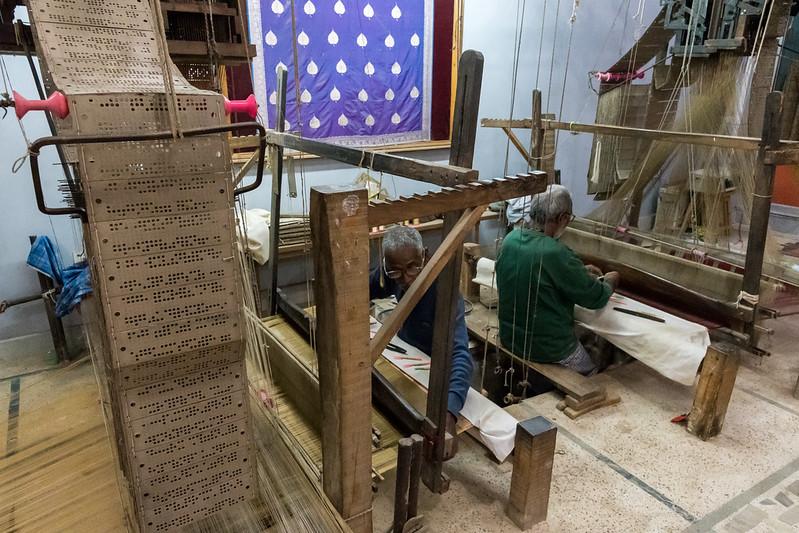 Silk weavers demonstrate their craft in Varanasi; notice the Jaquard-style cards.