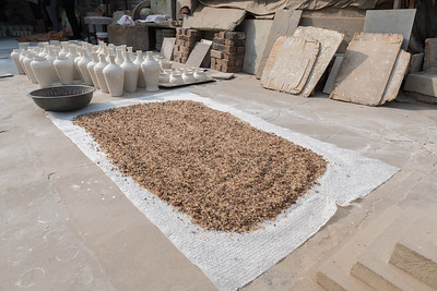 Demonstration of blue pottery in Jaipur; this gum from the sativa tree is crushed and mixed with quartz powder.