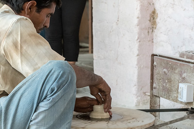 Demonstration of blue pottery in Jaipur; here he spins a small piece to attach to other molded pieces.