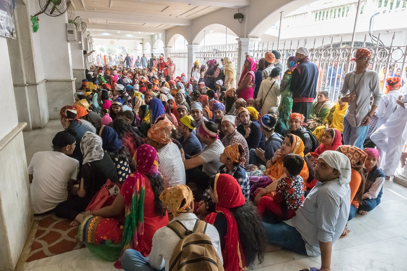 Hundreds of people await entrance to the hall where they will receive a free meal - Sikh temple, Delhi.