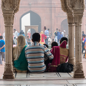 A family sits for a photo, Jama Masjid, Delhi.
