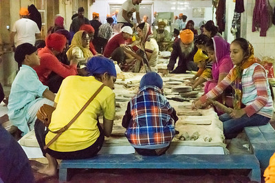 Even the smallest child can help roll chapatis at the Sikh temple in Delhi.