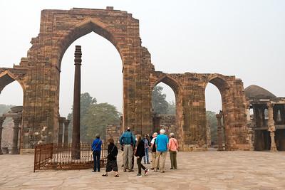 Iron pillar and ruins of ancient mosque, Qutb Minar, Delhi.